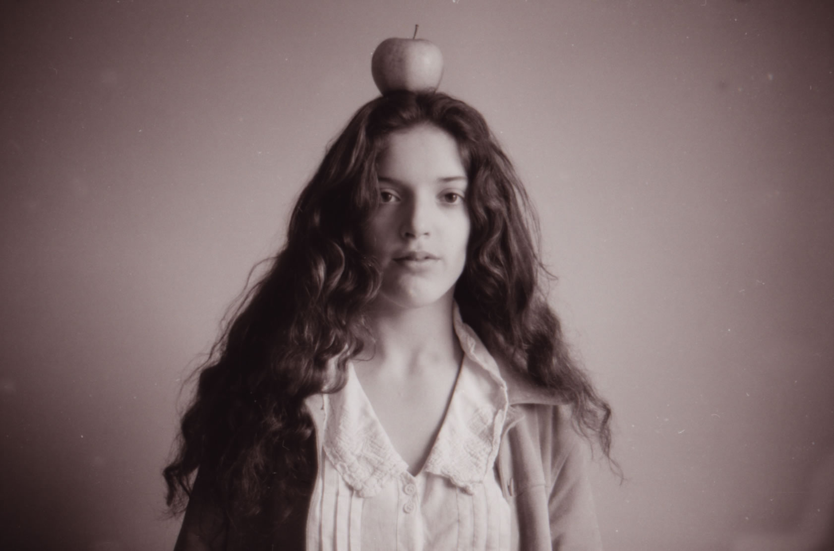 GIRL WITH APPLE ON HEAD