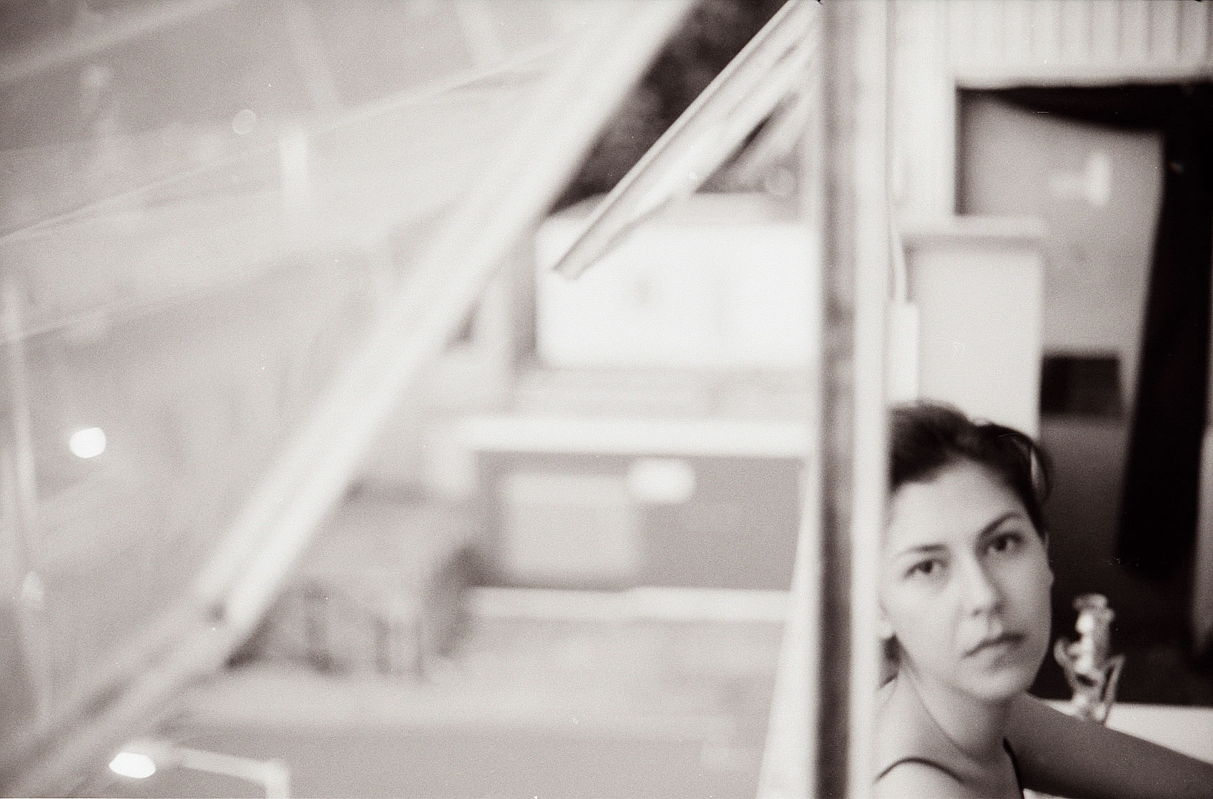 GIRL BY LARGE WINDOW