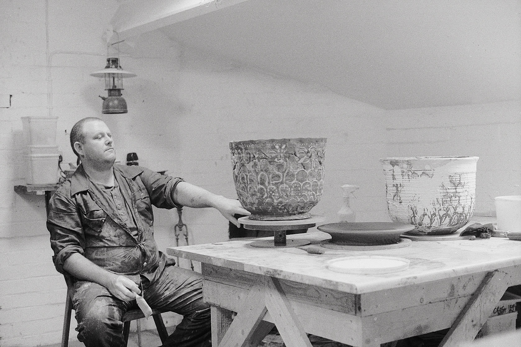 large man with ceramics