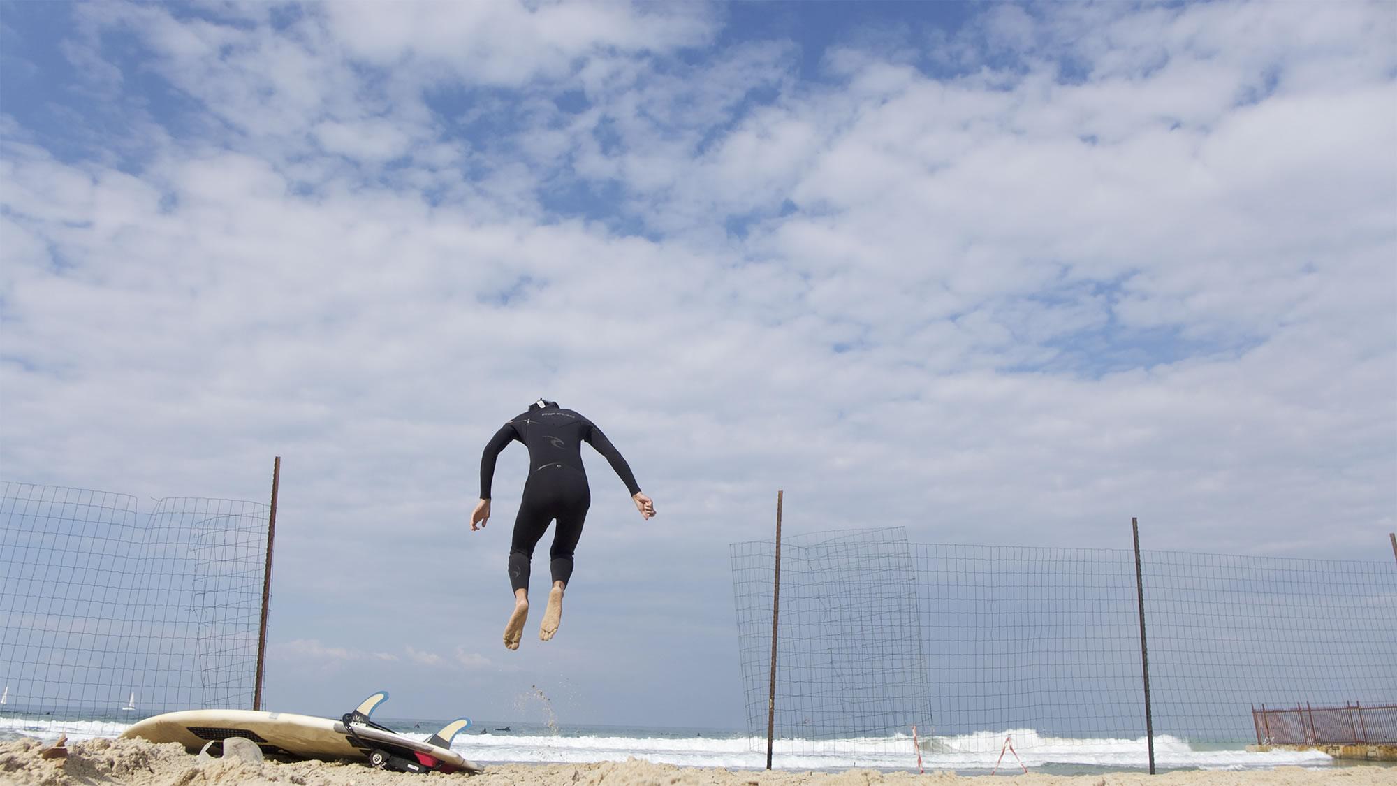 surfer jumping tel aviv