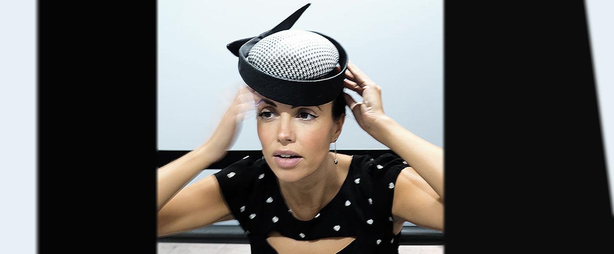 girl in john boyd hat